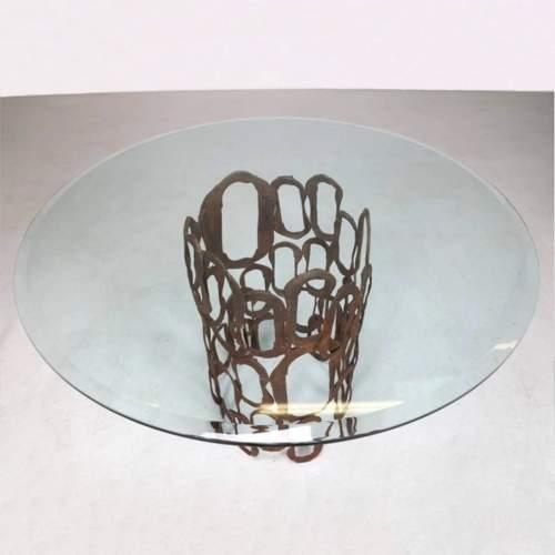 Angelo Rinaldi |Tavolo scultura |in ferro grezzo sagomato e patinato e cristallo| h. cm.80x120 | anni '70